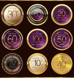 Anniversary purple and gold label collection Royalty Free Stock Photos