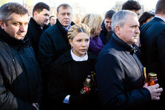 Anniversary of the Revolution of Dignity in Ukraine. KIEV, UKRAINE - NOV 21, 2014: Yulia Tymoshenko during a ceremony of laying flowers near the memorial cross Royalty Free Stock Photos