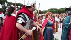 Anniversary Of Rome Foundation. ROME, ITALY - APRIL 19, 2015: Roman legionary soldiers and women from the antique Rome faithfully reconstructed by the Roman stock video footage