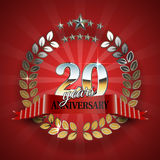 Anniversary 20th gold wreath with red ribbon. Royalty Free Stock Photos