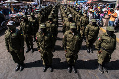 Anniversary of the uprising in Cheran, Mexico. Member of the volunteer self defense force march through town on the anniversary of the uprising.  April 15th 2014 Stock Image