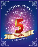 Anniversary 5 years. Anniversary card 5 years in a frame with ornament and firework on a blue background Royalty Free Stock Photo
