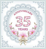 Anniversary 35 years. Anniversary card 35 years in a frame with an ornament and flowers Stock Photo