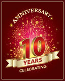 Anniversary  10 years. Anniversary card 10 years old with fireworks on claret background Stock Image