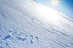 Anno 2011 scritto in neve Fotografia Stock Libera da Diritti