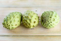Annona, Custard Apple, Cherimoya, Sugar Apple on Wood Table Background royalty free stock images
