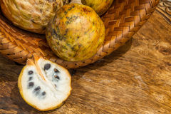 Annona scaly, sugar apple fruit. Divided half annona cherimola fruit. Royalty Free Stock Photo