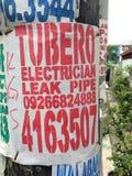 Annonce d'un plombier et d'un électricien Images libres de droits