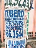 Annonce d'un plombier et d'un électricien Photos libres de droits