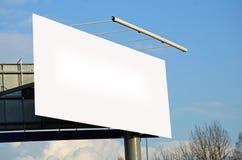 Annonsbilboard i en stad Royaltyfri Foto