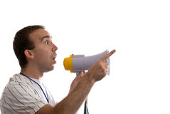 Announcement. A young man holding a blowhorn and pointing at white copyspace Stock Image