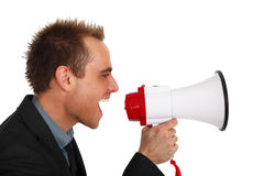 Announcement. Young businessman making an announcement with a megaphone Stock Images