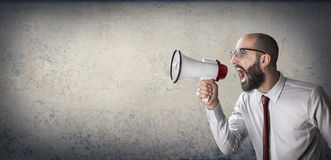 Announcement with megaphone. Man shouting at the megaphone Royalty Free Stock Images
