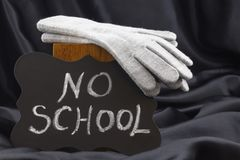NO SCHOOL sign on chalkboard against black satin warns of cold w. Announcement of NO SCHOOL on chalkboard notifies of winter weather closing stock photos