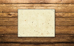 Announcement on wood. Announcement of paper on wooden texture Royalty Free Stock Images