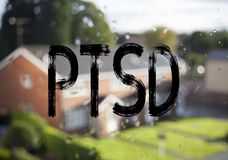 Announcement text caption showing PTSD Post-Traumatic Stress Disorder . Business concept for Health Treatment written on old brick Stock Photo