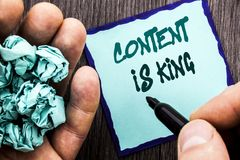 Announcement text showing Content Is King. Business concept for Online Marketing Information Management With cms Or Seo Data writt. En Notebook Book Man Writing Stock Image