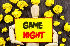Announcement text showing Game Night. Concept meaning Entertainment Fun Play Time Event For Gaming written on Sticky Note Holding. Announcement text showing Game royalty free stock image