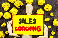 Announcement text showing Sales Coaching. Concept meaning Business Goal Achievement Mentoring written on Sticky Note Holding By Sc. Announcement text showing Royalty Free Stock Photo