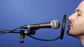 Announcer. Man recording voice in professional audio studio Royalty Free Stock Photos