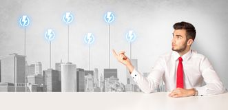 Announcer presenting the city energy consumption. Announcer sitting at desk presenting the city energy consumption royalty free stock photo