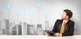Announcer presenting the city energy consumption. Announcer sitting at desk presenting the city energy consumption royalty free stock image
