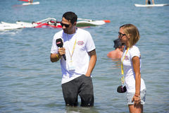 Announcers In Live Broadcast. Alacatı,Cesme, Izmir,Turkey- August 18, 2015:Two announcer are getting ready for Power TV live broadcast in the sea, in Alacatı Royalty Free Stock Photography