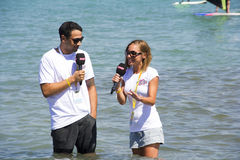Announcers In Live Broadcast. Alacatı,Cesme, Izmir,Turkey- August 18, 2015:Two announcer are talking with each other in the sea for Power TV live broadcast in Stock Photos