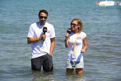 Announcers In Live Broadcast. Alacatı,Cesme, Izmir,Turkey- August 18, 2015:Two announcer are talking with each other in the sea for Power TV live broadcast in Royalty Free Stock Image