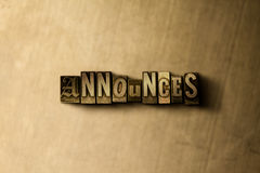 ANNOUNCES - close-up of grungy vintage typeset word on metal backdrop Royalty Free Stock Photography