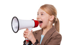Announcing good news. Cheerful little girl in formalwear shouting at megaphone while standing isolated on white Royalty Free Stock Photo