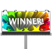 Announcing the Winner on a Huge Billboard for Top Prize. An outdoor billboard announces to the word that the winner has been chosen and congratulates the lucky Stock Photography