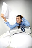 Annoyance. Portrait of nervous businessman holding printed papers Stock Photography