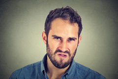 Annoyance. Angry displeased man Royalty Free Stock Photography