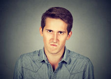 Annoyance. Angry displeased young man Royalty Free Stock Image