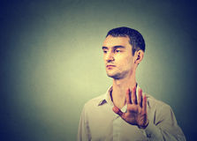 Annoyed angry man with bad attitude giving talk to hand gesture royalty free stock images