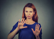 Annoyed angry woman with bad attitude gesturing with palms outward to stop Stock Image