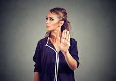 Annoyed angry woman with bad attitude giving talk to hand gesture Royalty Free Stock Photos