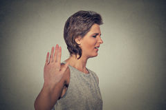 Annoyed angry woman with bad attitude giving talk to hand gesture Stock Images
