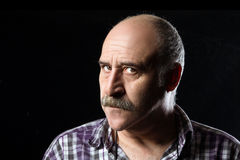 Annoyed Bald Man with Mustaches. Angry Expression. Portrait of annoyed bald man with a big mustache expressing anger Stock Image