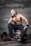 Annoyed bodybuilder. Talking on the phone Stock Photos