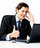 Annoyed business man with a laptop Royalty Free Stock Photo