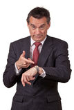 Annoyed Business Man Pointing at Watch Stock Image