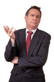 Annoyed Business Man in Suit Raising Hand Stock Photo