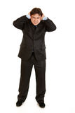 Annoyed businessman  closing ears with hands Royalty Free Stock Photos