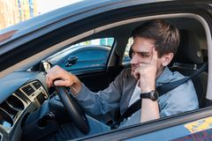 Free Annoyed Businessman In Car Stuck In Traffic Jam Royalty Free Stock Images - 161053439