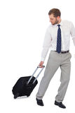 Annoyed businessman with suitcase Royalty Free Stock Images