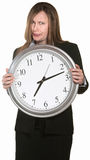 Annoyed Businesswoman with Clock Royalty Free Stock Photos