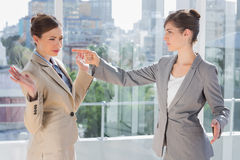 Annoyed businesswoman pointing at her rival Stock Photos