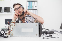 Annoyed computer engineer making a call Royalty Free Stock Photo